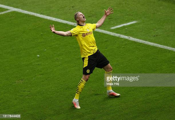 Erling Haaland of Borussia Dortmund celebrates his team's second goal during the DFB Cup final match between RB Leipzig and Borussia Dortmund at...