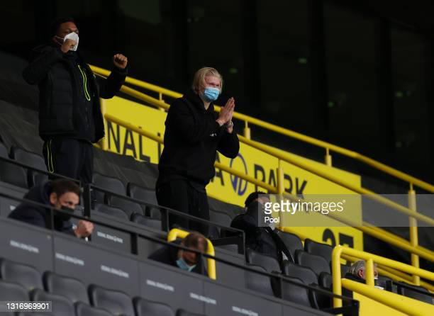 Erling Haaland of Borussia Dortmund celebrates in the stands after his team's third goal, scored by teammate Jadon Sancho of Borussia Dortmund during...