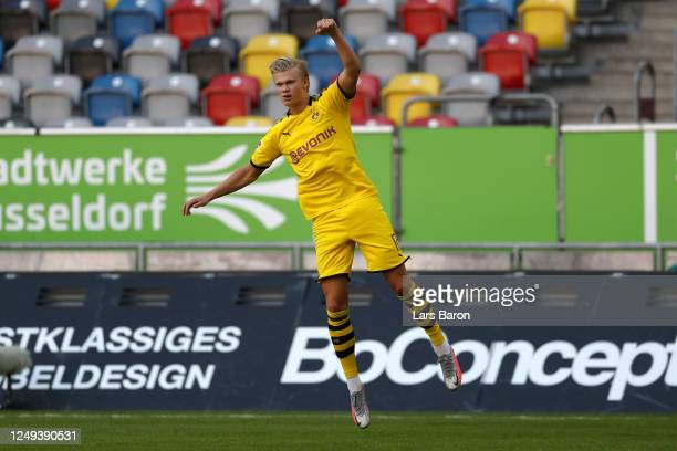 Erling Haaland of Borussia Dortmund celebrates scoring a goal during the Bundesliga match between Fortuna Duesseldorf and Borussia Dortmund at Merkur...