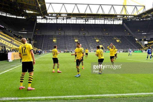 Erling Haaland of Borussia Dortmund celebrates scoring his side's first goal with team mates during the Bundesliga match between Borussia Dortmund...