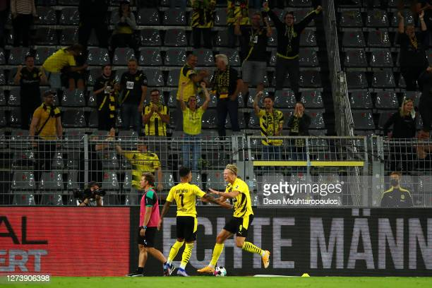 Erling Haaland of Borussia Dortmund celebrates scoring his teams third goal of the game with team mate Jadon Sancho during the Bundesliga match...