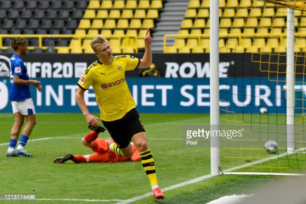 Erling Haaland of Borussia Dortmund celebrates scoring his team's first goal during the Bundesliga match between Borussia Dortmund and FC Schalke 04...