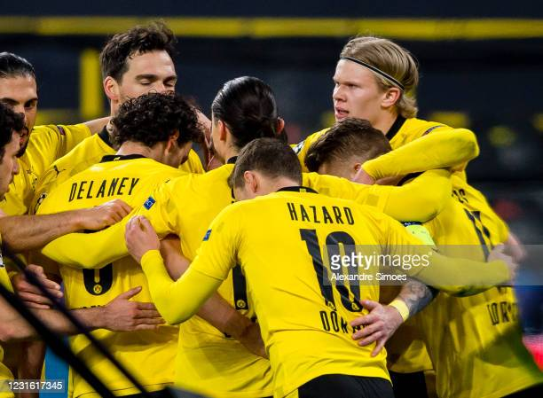 Erling Haaland of Borussia Dortmund celebrates scoring the opening goal with his team mates during the Champions League match between Borussia...