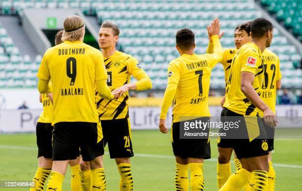 Erling Haaland of Borussia Dortmund celebrates scoring the opening goal during the Bundesliga match between VfL Wolfsburg and Borussia Dortmund at...