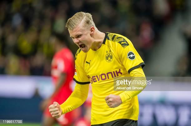 Erling Haaland of Borussia Dortmund celebrates the goal of Raphael Guerreiro during the Bundesliga match between Bayer 04 Leverkusen and Borussia...