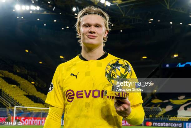 Erling Haaland of Borussia Dortmund celebrates the win and his Man Of The Match trophy after the final whistle during the Champions League match...