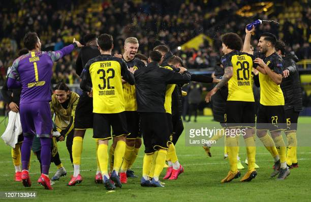 Erling Haaland of Borussia Dortmund celebrates victory with his team mates the UEFA Champions League round of 16 first leg match between Borussia...
