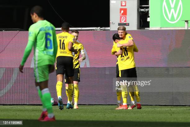 Erling Haaland of Borussia Dortmund celebrates with Emre Can after scoring their team's second goal during the Bundesliga match between VfL Wolfsburg...