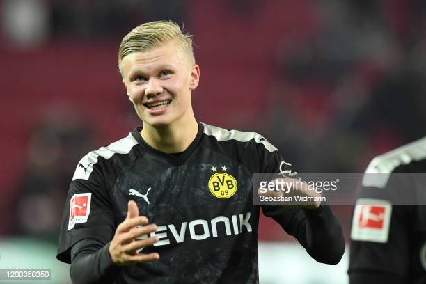 Erling Haaland of Borussia Dortmund celebrates with fans after the Bundesliga match between FC Augsburg and Borussia Dortmund at WWKArena on January...
