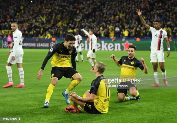 Erling Haaland of Borussia Dortmund celebrates with Gio Reyna and Raphael Guerreiro after scoring his team's first goal during the UEFA Champions...