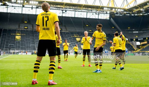 Erling Haaland of Borussia Dortmund celebrates with his team mates after scoring his teams first goal during the Bundesliga match between Borussia...