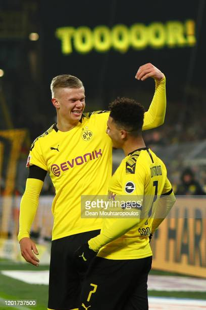 Erling Haaland of Borussia Dortmund celebrates with Jadon Sancho of Borussia Dortmund after he scores his sides 5th goal and his 2nd of the game...