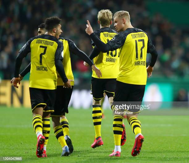 Erling Haaland of Borussia Dortmund celebrates with Jadon Sancho after scoring his team's first goal during the DFB Cup round of sixteen match...