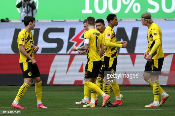 Erling Haaland of Borussia Dortmund celebrates with Jude Bellingham after scoring their team's first goal during the Bundesliga match between VfL...