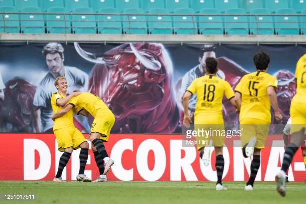 Erling Haaland of Borussia Dortmund celebrates with Julian Brandt of Borussia Dortmund after scoring second goal during the Bundesliga match between...