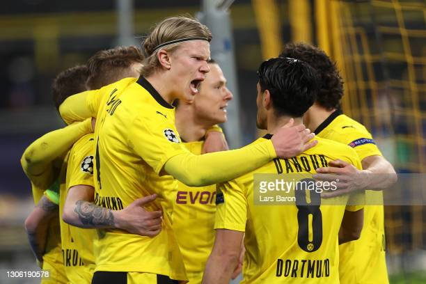 Erling Haaland of Borussia Dortmund celebrates with Mahmoud Dahoud after scoring their side's first goal during the UEFA Champions League Round of 16...