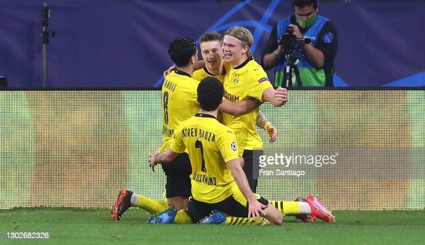 Erling Haaland of Borussia Dortmund celebrates with Marco Reus and team mates after scoring their side's third goal during the UEFA Champions League...