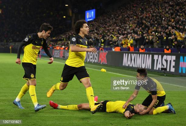 Erling Haaland of Borussia Dortmund celebrates with Raphael Guerreiro after scoring his team's second goal during the UEFA Champions League round of...