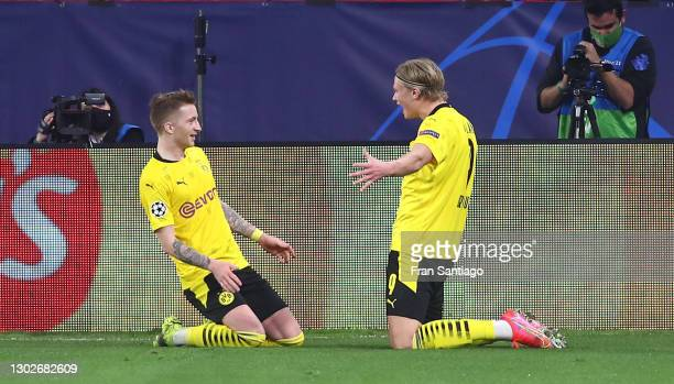 Erling Haaland of Borussia Dortmund celebrates with team mate Marco Reus after scoring their side's third goal during the UEFA Champions League Round...