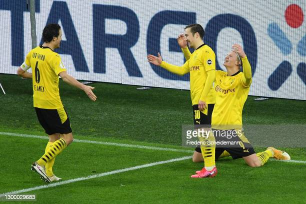 Erling Haaland of Borussia Dortmund celebrates with team mates Thomas Delaney and Felix Passlack after scoring their side's third goal during the DFB...