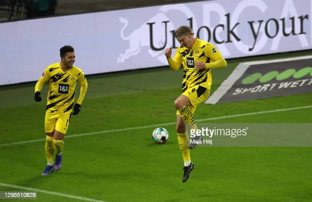 Erling Haaland of Borussia Dortmund celebrates with teammate Jadon Sancho after scoring their sides second goal during the Bundesliga match between...