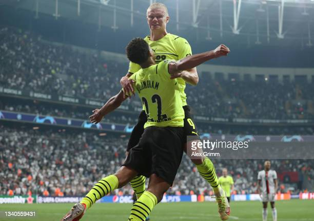 Erling Haaland of Borussia Dortmund celebrates with teammate Jude Bellingham after scoring their side's second goal during the UEFA Champions League...