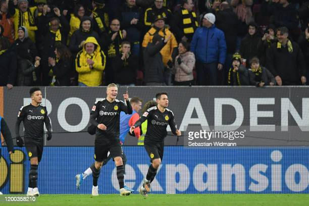 Erling Haaland of Borussia Dortmund celebrates with teammates Jadon Sancho and Raphael Guerreiro after his team's third goal during the Bundesliga...