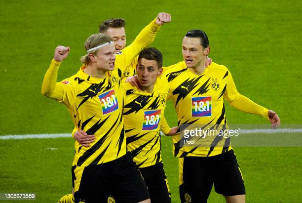Erling Haaland of Borussia Dortmund celebrates with teammates Thorgan Hazard and Nico Schulz after scoring their team's second goal during the...