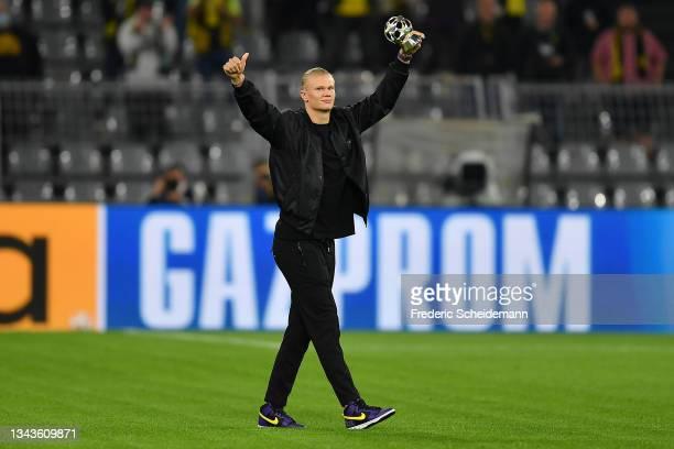 Erling Haaland of Borussia Dortmund celebrates with the Forward of the Season award for the 2020/21 UEFA Champions League season prior to the UEFA...