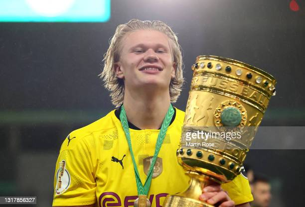 Erling Haaland of Borussia Dortmund celebrates with the trophy after winning the DFB Cup final match between RB Leipzig and Borussia Dortmund at...