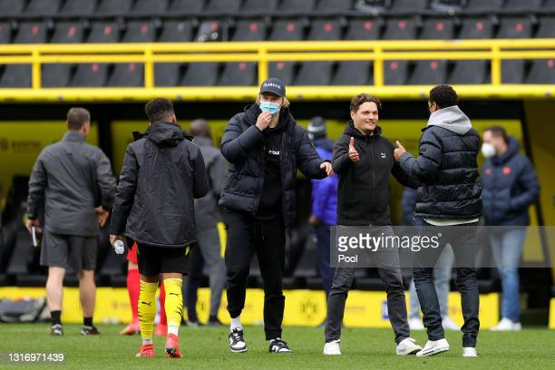 Erling Haaland of Borussia Dortmund, Edin Terzic, Head Coach of Borussia Dortmund and Jude Bellingham of Borussia Dortmund celebrate following their...