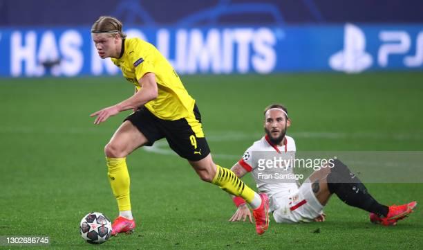 Erling Haaland of Borussia Dortmund gets away from Nemanja Gudelj of Sevilla during the UEFA Champions League Round of 16 match between Sevilla FC...