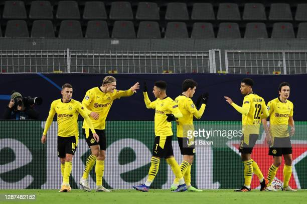 Erling Haaland of Borussia Dortmund high fives team mate Jadon Sancho after scoring his team's first goal during the UEFA Champions League Group F...