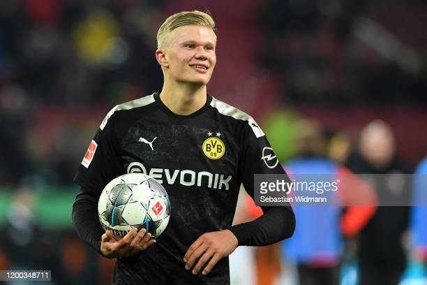 Erling Haaland of Borussia Dortmund holds the match ball after the Bundesliga match between FC Augsburg and Borussia Dortmund at WWKArena on January...