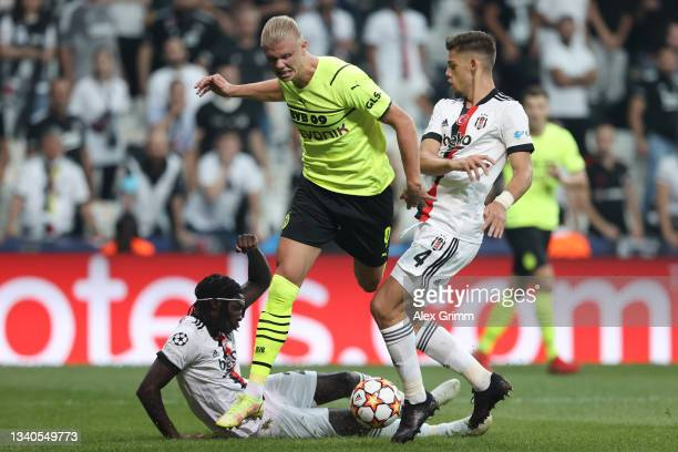 Erling Haaland of Borussia Dortmund is challenged by Francisco Montero and Fabrice N'Sakala of Besiktas during the UEFA Champions League group C...