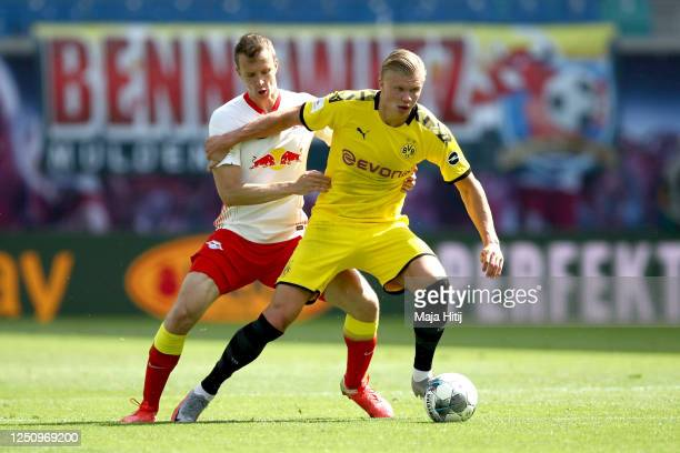 Erling Haaland of Borussia Dortmund is challenged by Lukas Klostermann of RB Leipzig during the Bundesliga match between RB Leipzig and Borussia...