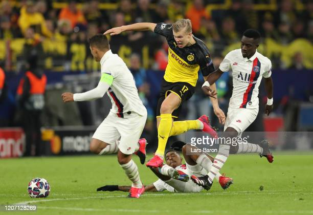 Erling Haaland of Borussia Dortmund is challenged by Thiago Silva Presnel Kimpembe and Idrissa Gueye of Paris SaintGermain during the UEFA Champions...