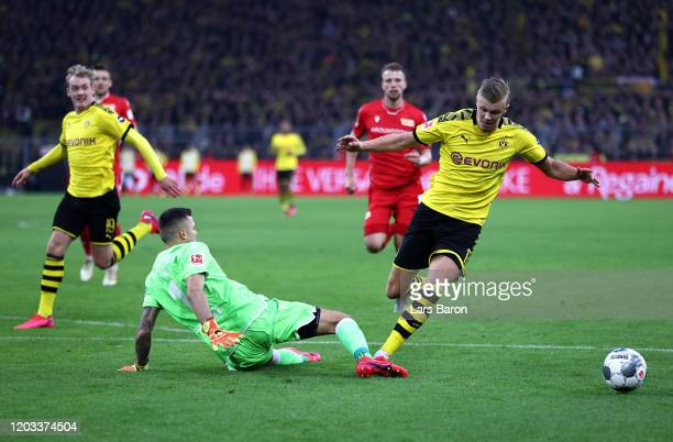 Erling Haaland of Borussia Dortmund is fouled by Rafa Gikiewicz of 1 FC Union Berlin and a penalty is later awarded during the Bundesliga match...