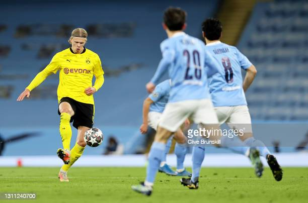 Erling Haaland of Borussia Dortmund passes the ball during the UEFA Champions League Quarter Final match between Manchester City and Borussia...