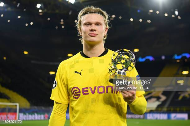 Erling Haaland of Borussia Dortmund poses for a photo with the UEFA Champions League Player of the Match award after the UEFA Champions League Round...