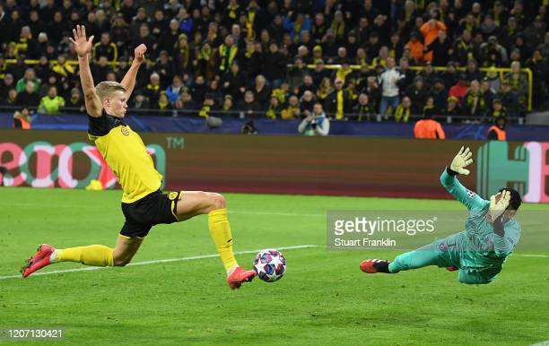 Erling Haaland of Borussia Dortmund scores his team's first goal past Keylor Navas of Paris SaintGermain during the UEFA Champions League round of 16...
