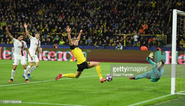 Erling Haaland of Borussia Dortmund scores his team's first goal past Keylor Navas of Paris Saint-Germain during the UEFA Champions League round of...