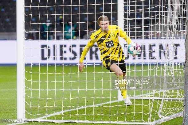 Erling Haaland of Borussia Dortmund scores his team's first goal during the Bundesliga match between Hertha BSC and Borussia Dortmund at...