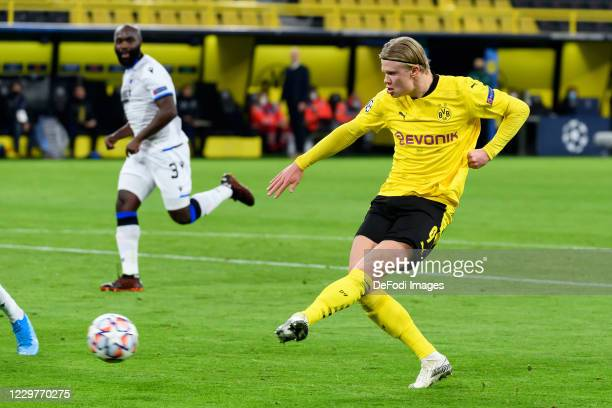 Erling Haaland of Borussia Dortmund scores his team's first goal during the UEFA Champions League Group F stage match between Borussia Dortmund and...