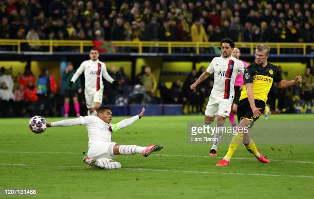 Erling Haaland of Borussia Dortmund scores his team's second goal as Thiago Silva of Paris Saint-Germain attempts to score during the UEFA Champions...