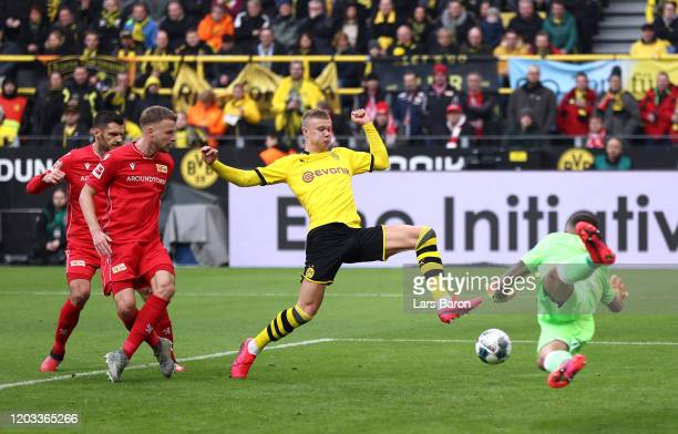 Erling Haaland of Borussia Dortmund scores his team's second goal past Rafa1 Gikiewicz of 1. FC Union Berlin during the Bundesliga match between...