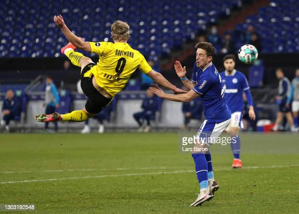 Erling Haaland of Borussia Dortmund scores his team's second goal during the Bundesliga match between FC Schalke 04 and Borussia Dortmund at...
