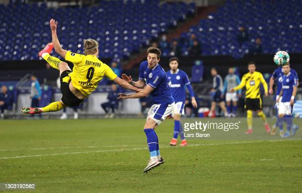 Erling Haaland of Borussia Dortmund scores his team's second goal during the Bundesliga match between FC Schalke 04 and Borussia Dortmund at...