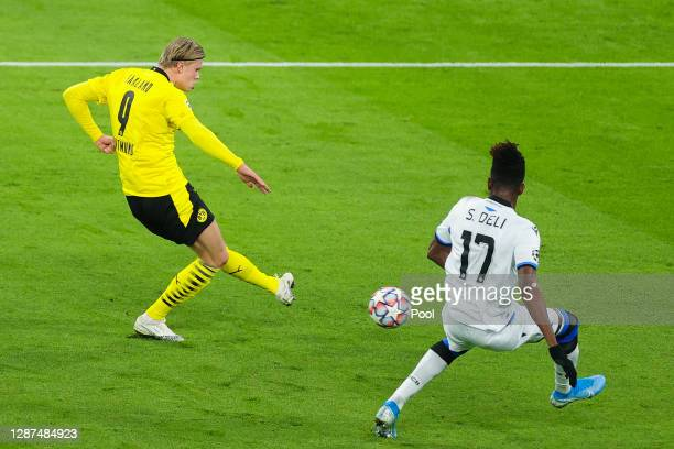 Erling Haaland of Borussia Dortmund scores their sides first goal during the UEFA Champions League Group F stage match between Borussia Dortmund and...