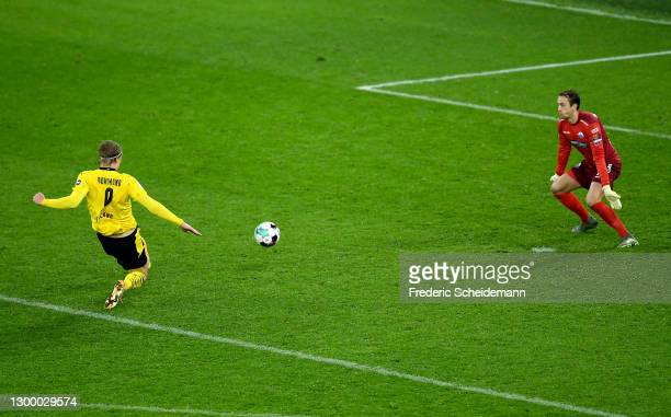 Erling Haaland of Borussia Dortmund scores their side's third goal past Leopold Zingerle of SC Paderborn during the DFB Cup Round of Sixteen match...